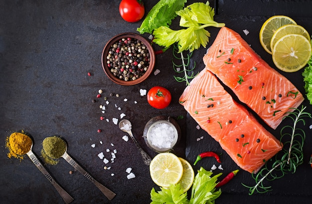 Raw salmon fillet and ingredients for cooking Free Photo