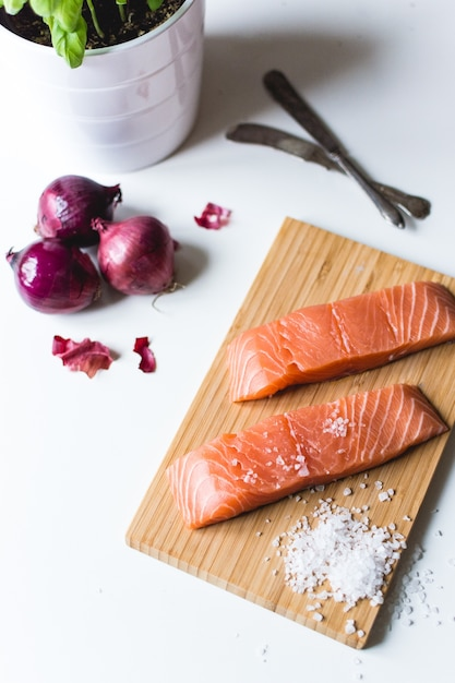 Raw salmon fillets prepared for cooking Free Photo