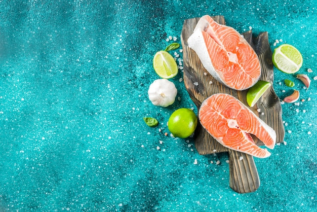 Raw salmon fish steaks with spices Premium Photo
