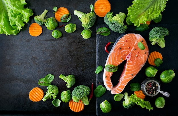 Raw salmon steak and ingredients for cooking. top view Free Photo