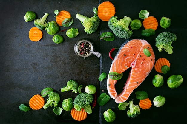 Raw salmon steak and ingredients for cooking Free Photo
