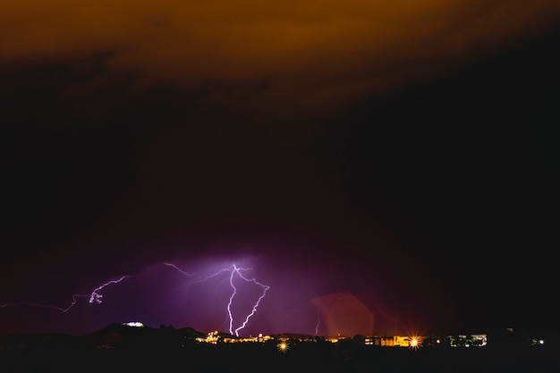 Rays in a night storm with light and clouds. Premium Photo