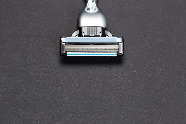 Razor on a black ,  of a razor blade, Premium Photo