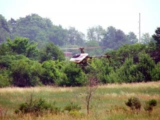 rc helicopter in flight Free Photo