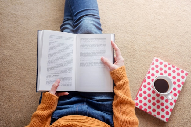 Reading concept. soft focus of  young woman relaxing by book in cozy house Premium Photo