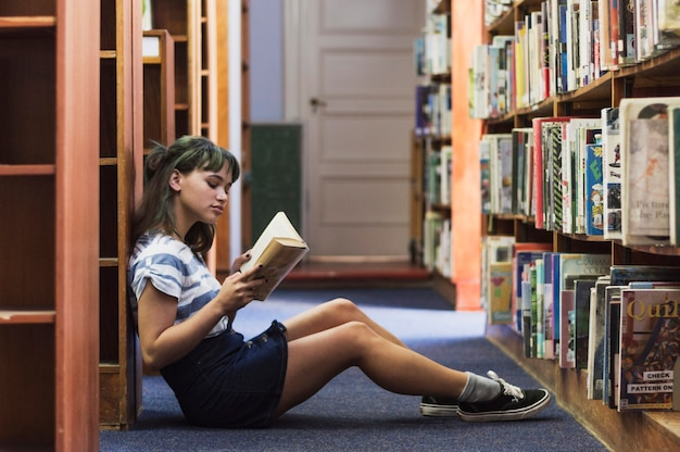 Reading Girl Sitting On Library Floor Photo Free Download