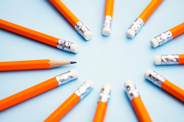 Ready for adding text. businesseducational . yellow pencils on blue . Premium Photo