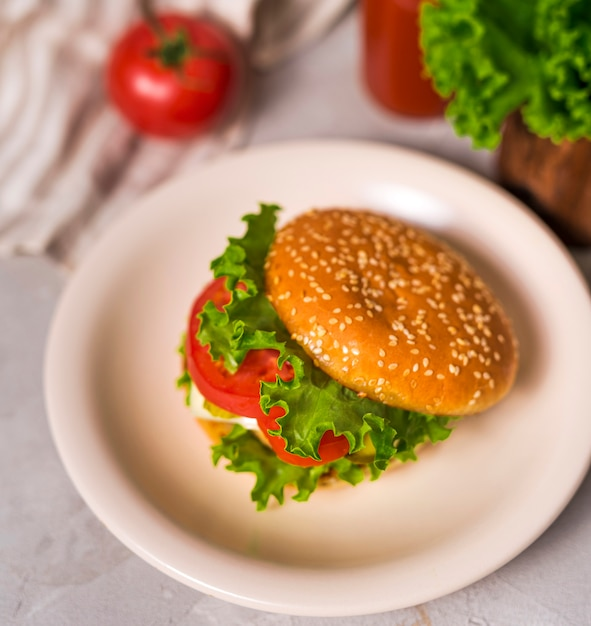 Ready to be served burger on a plate Free Photo