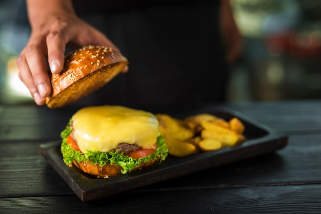 Ready to be served burger with melted cheese Free Photo