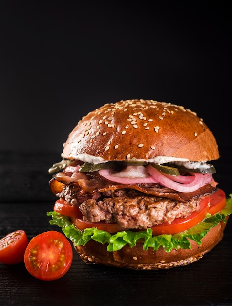 Ready to be served classic hamburger with cherry tomatoes Free Photo