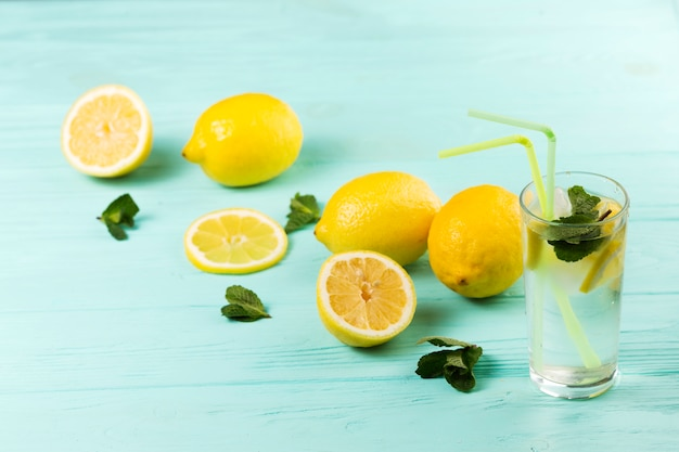 Ready cold citrus mint water and lemons Free Photo