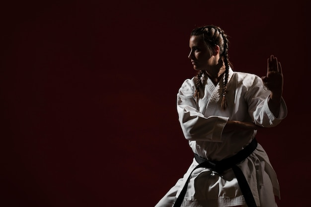 Ready to fight woman in white karate uniform Free Photo