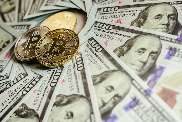 Real bitcoins with a value higher than hundreds of dollars in bills. Premium Photo