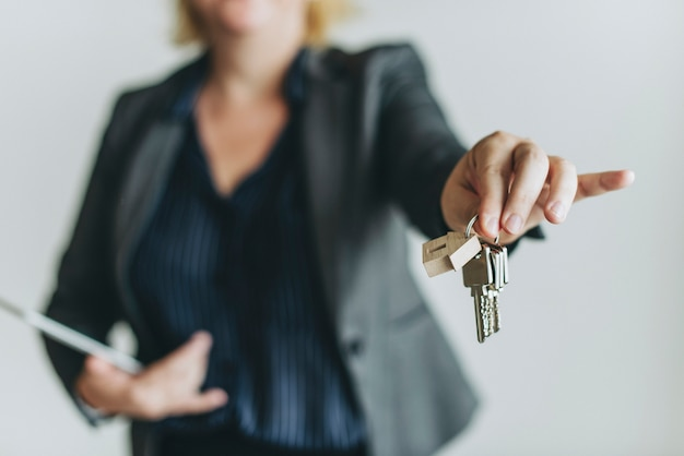 Real estate agent handing over the keys Premium Photo
