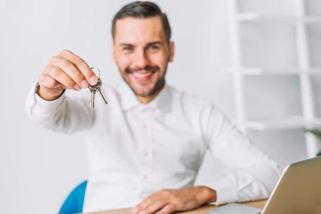 real estate agent holding keys photo
