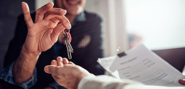 Real estate agent passing keys to his client Premium Photo