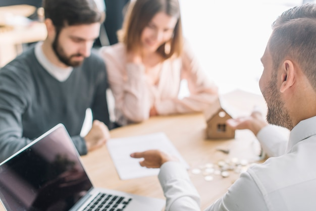 real estate agent talking with clients photo