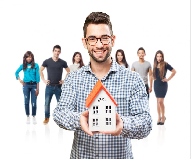 real estate agent with a model home photo