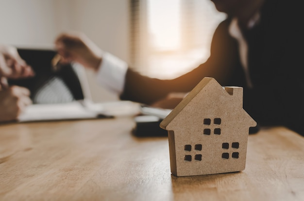 Real estate broker manager giving keys to customer after signing contract Premium Photo