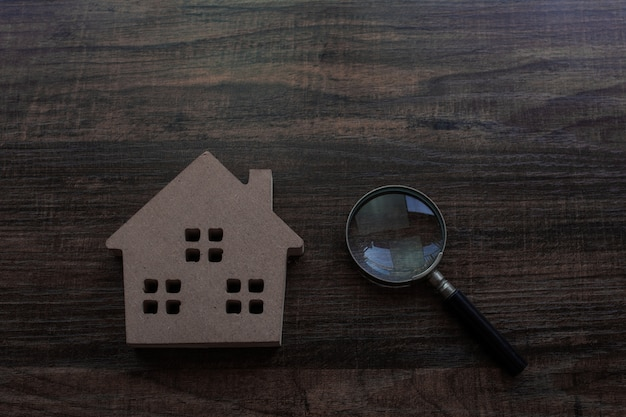 Real estate and inspector concept, house model and magnifying glass on wood table Premium Photo
