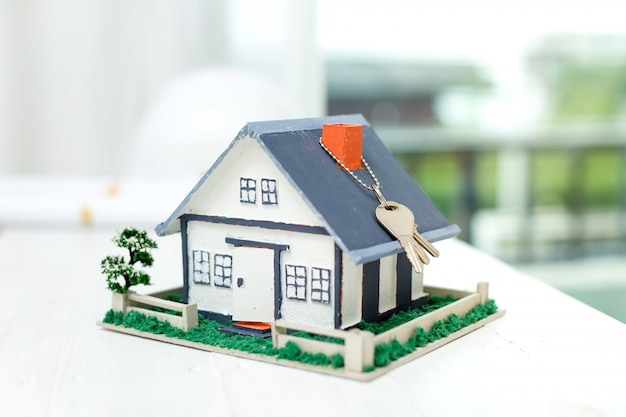 Real estate with house model and keys Free Photo