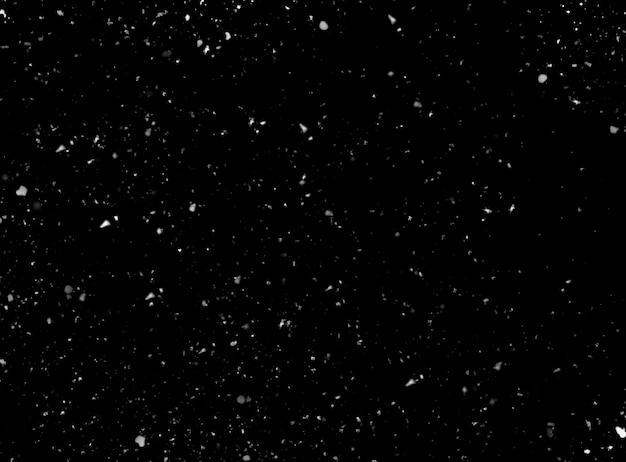 Real snow on black background as texture Premium Photo