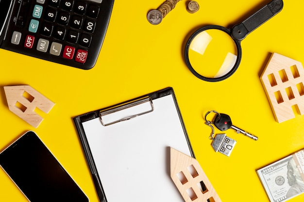 Real state objects on yellow background Free Photo