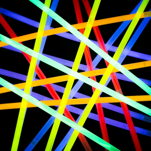 Realistic colorful neon electric laser beam on dark background Free Photo