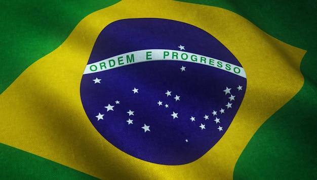 Реалистичный снимок развевающегося флага бразилии с интересными текстурами Бесплатные Фотографии