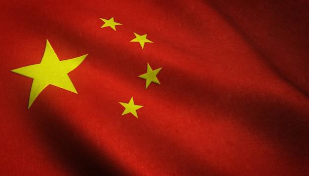 興味深いテクスチャを持つ中国の旗を振っているのリアルなショット 無料写真
