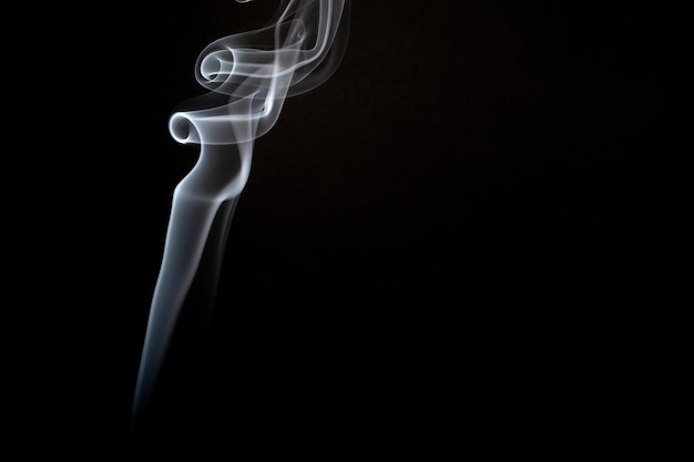 Realistic shot of a wisp of smoke against a black background Free Photo