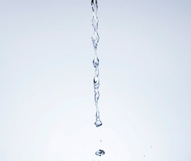 Realistic water poured on light background Free Photo