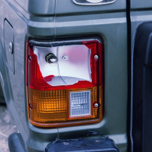 The rear lamp of the silver car broken by the accident. concepts- accident, car insurance, traffic accident. Premium Photo