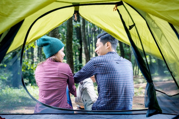 Rear view of asian couple relaxing outside the tent Premium Photo