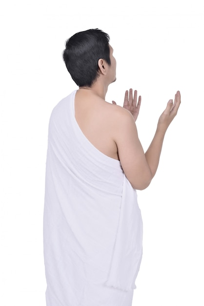 Rear view of asian muslim man in ihram cloth praying Premium Photo