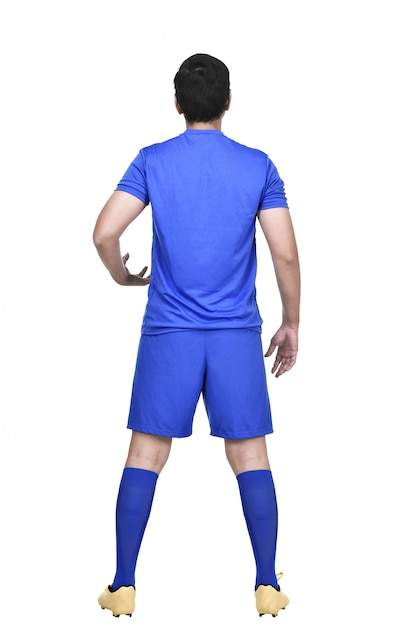 Rear view of asian soccer player in blue jersey Premium Photo