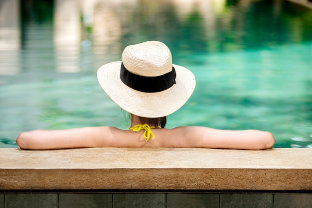Rear view of asian woman with hat relaxing Premium Photo