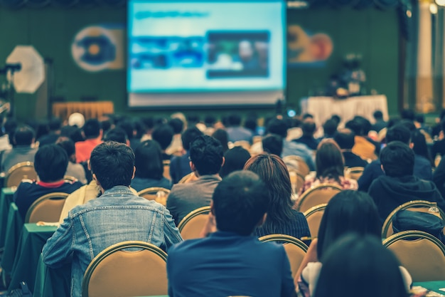 Rear view of audience in the conference hall or seminar meeting Premium Photo