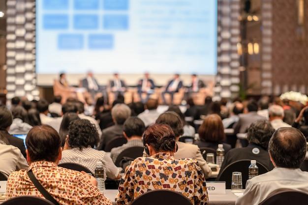 Rear view of audience listening speakers Premium Photo