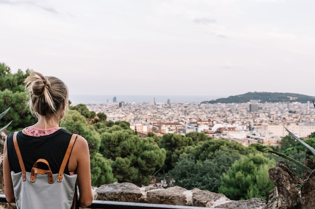 Rear view of a blond woman looking at barcelona city view Premium Photo