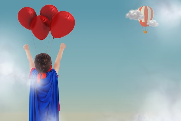 Rear view of boy with cloak and balloons Free Photo