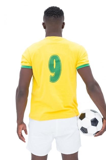 Rear view of brazilian football player Premium Photo
