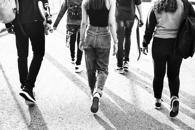 Rear view of group of school friends walking outdoors lifestyle Free Photo