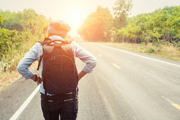 Rear view of adventurer walking at sunset 1150 302