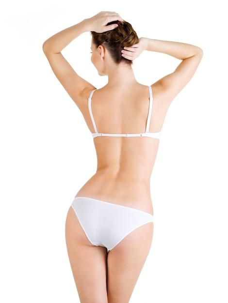 아름다운 여성의 몸의 후면보기. 흰색으로 격리. 무료 사진