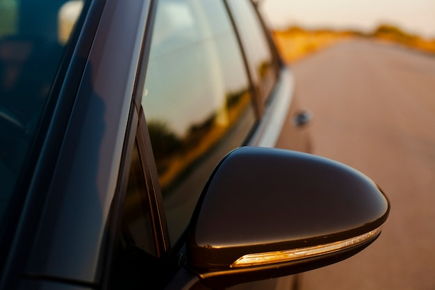 Rearview mirror on the background of the road Free Photo