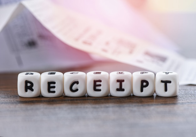 Receipt paper on the table office with dices words Premium Photo