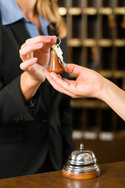 Reception, guest checking in a hotel Premium Photo