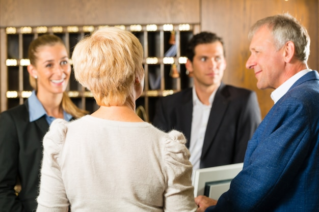 Reception, guests check in a hotel Premium Photo