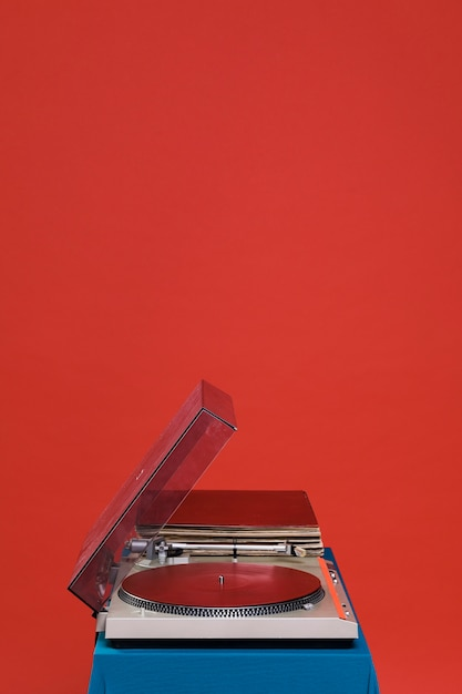Record player on red background Free Photo